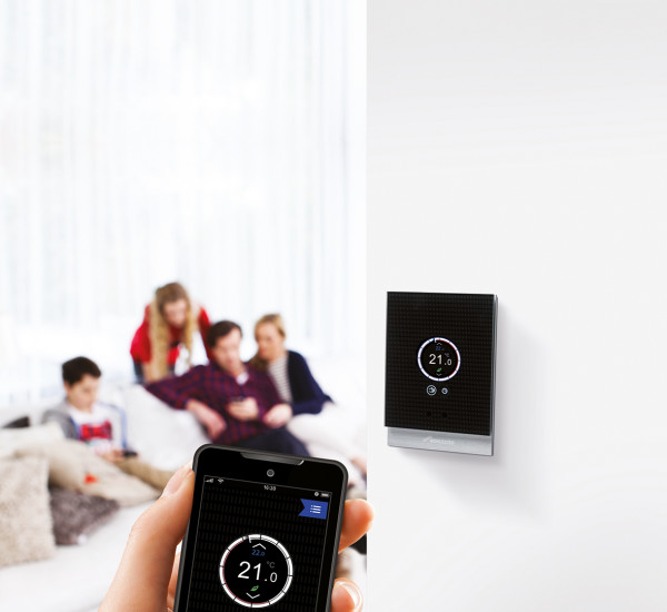 An image showing someone controlling their heating with an app