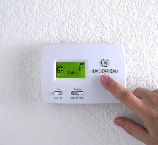 An image of a digital heating control on a wall