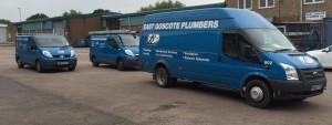 An image showing East Goscote Plumbers livered vans parked outside