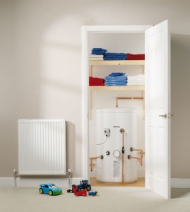 An image showing an unvented cylinder in anairing cupboard
