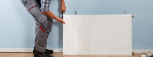 an image showing a central heating radiator being installed by a heating engineer from EGP Plumbers