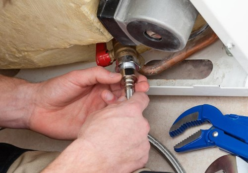 An image of a member of EGP Plumbers carrying our a boiler repair