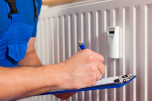 An image of an EGP Plumber engineer carrying out radiator checks