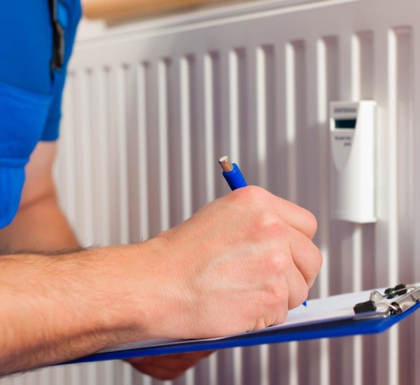 An image of a qualified EGP Plumbers engineer carrying out Radiator heating distribution check