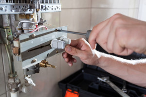 An image of a qualified engineer repairing Gas Heating