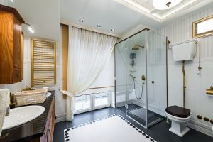 An image of a large bathroom with a toilet, shower and sink cabinet that has been fitted by EGP Plumbers