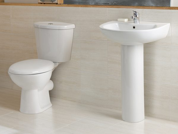 An image of white a toilet and sink fitted by EGP Plumbers
