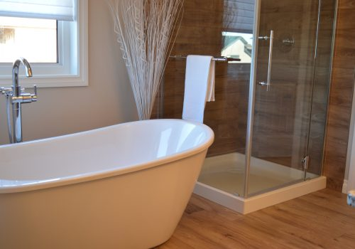 An image of a small bathroom with a separate bath and shower.