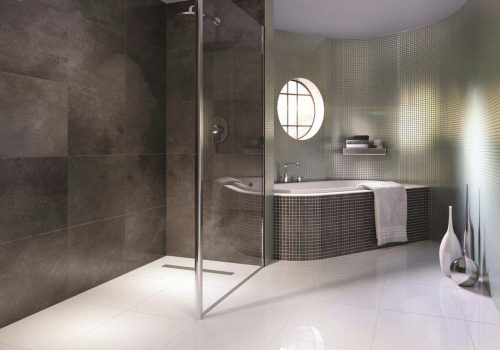 An image of a wet room with a bath and shower area.