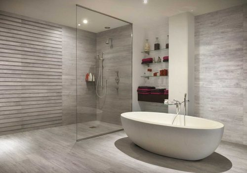 An image of a modern wet room with a free standing bath.